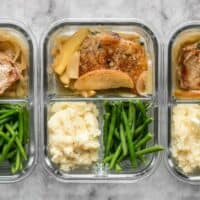 This Apple Spice Pork Chop meal prep is packed with tender and juicy pork chops, creamy mashed potatoes, and bright green beans. BudgetBytes.com
