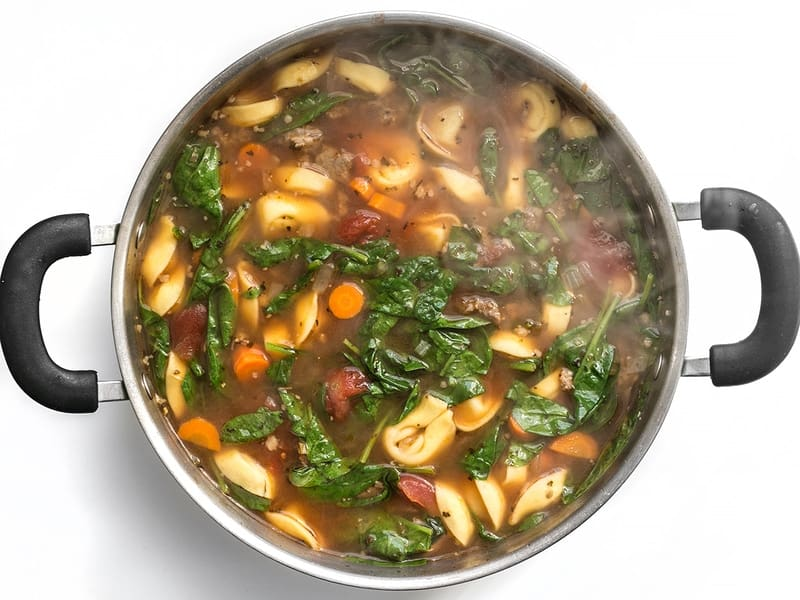 Wilted Spinach in Sausage and Tortelloni Soup