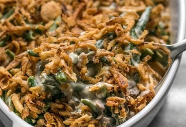 """This is the Creamiest Green Bean Casserole you'll ever make with no """"cream of"""" soups. The ingredient list is short and simple, but flavors are classic and comforting. BudgetBytes.com"""