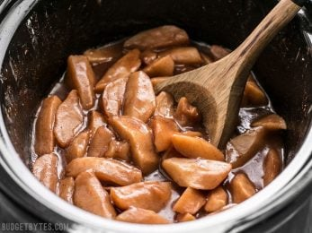 Slow Cooker Hot Buttered Apples are an easy and versatile dessert that is perfect for using up your glut of autumn apples! BudgetBytes.com
