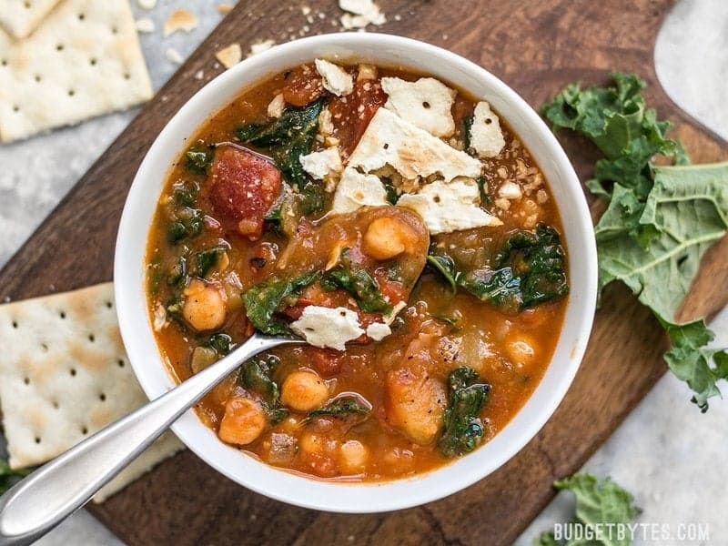 This Smoky Potato and Chickpea Stew is a hearty and filling plant-based dish that will keep you full and warm this winter! BudgetBytes.com