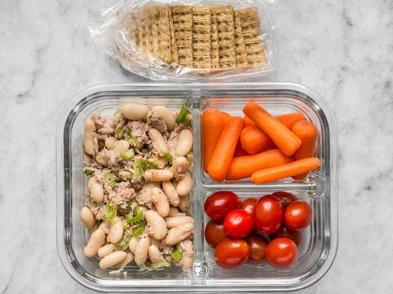 One Tuna and White Bean Meal Prep container with crackers on the side