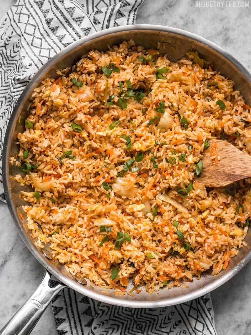 This Kimchi Fried rice is tangy, spicy, and the perfect way to use up all the leftover ingredients and scraps in your kitchen. BudgetBytes.com
