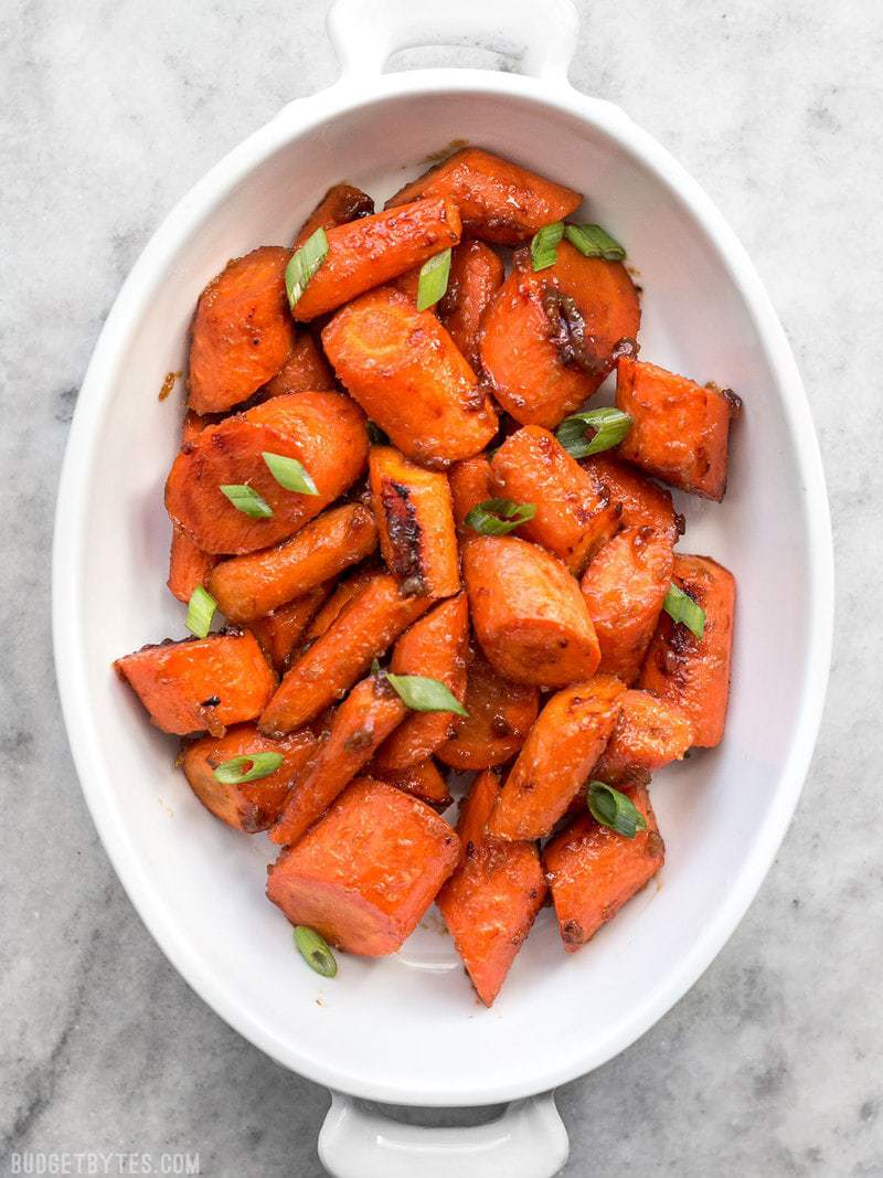 These Maple Miso Roasted Carrots are sweet, savory, and rich, and make a great side dish to any Asian inspired meal. BudgetBytes.com