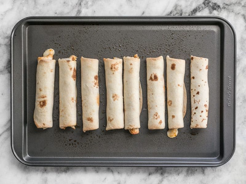 Baked Pizza Roll Ups on a baking sheet