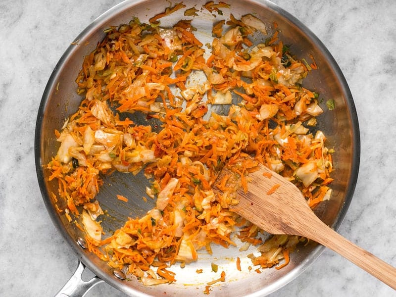 Add kimchi to the skillet