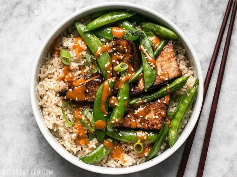 These vegan Soy Marinated Tofu Bowls are full of rich flavors and plenty of texture to keep your taste buds happy and your belly full. BudgetBytes.com