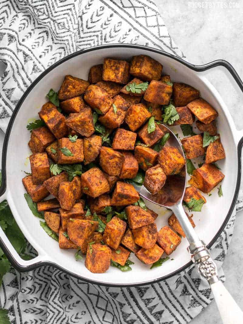 Finished Moroccan Spiced Sweet Potatoes in a serving dish with cilantro
