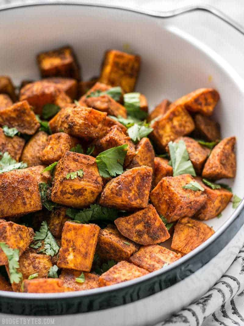 Close up of Moroccan Spiced Sweet Potatoes in dish with cilantro