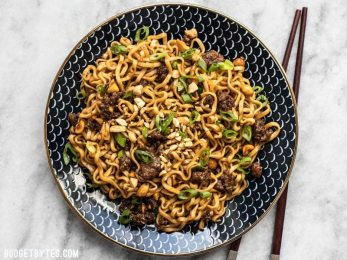 Sweet, salty, rich, and crunchy, these Pork and Peanut Dragon Noodles hit all the bases. It's fast, easy comfort food for busy nights! BudgetBytes.com