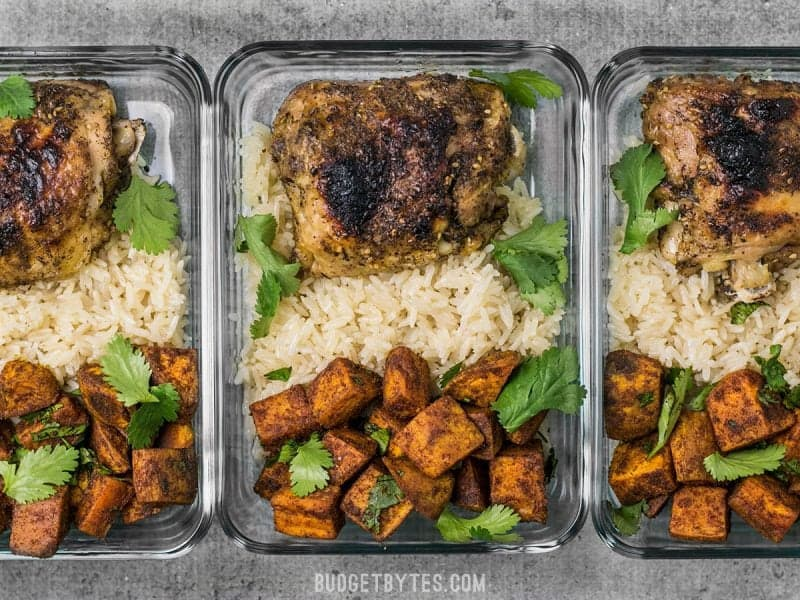 This Pressure Cooker Chicken and Rice Meal Prep combines spicy Moroccan Spiced Sweet Potatoes with tender chicken and savory rice. BudgetBytes.com