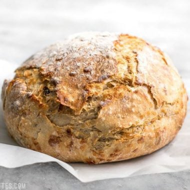 This Tomato Basil No Knead Bread is the perfect partner for your winter soups and stews, and is half the cost of a store bought artisan loaf. BudgetBytes.com