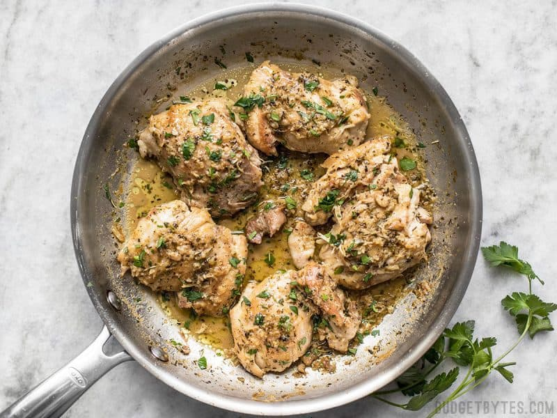 A quick and buttery herb pan sauce transforms these simple chicken thighs into decadent Herb Butter Chicken Thighs. BudgetBytes.com