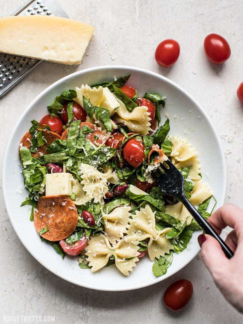 Pepperoni's rich and peppery bite is the perfect contrast to mild spinach, mozzarella, and pasta in this Pepperoni Pasta Salad. BudgetBytes.com