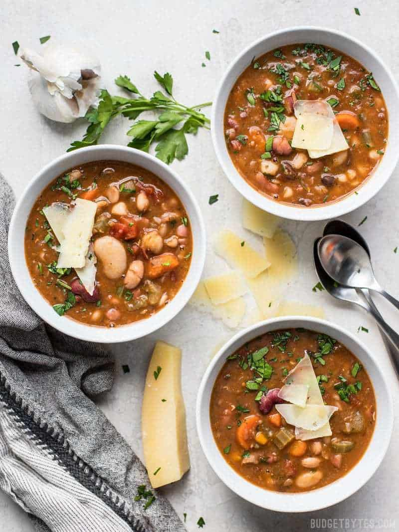 A variety of beans, fresh vegetables, and vibrant herbs and spices make this Vegetarian 15 Bean Soup flavorful, filling, AND incredibly good for you. BudgetBytes.com
