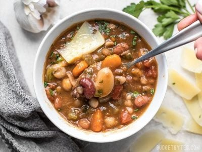 A variety of colors, fresh vegetables, and vibrant herbs and spices make this Vegetarian 15 Bean Soup flavorful, filling, AND incredibly good for you. BudgetBytes.com