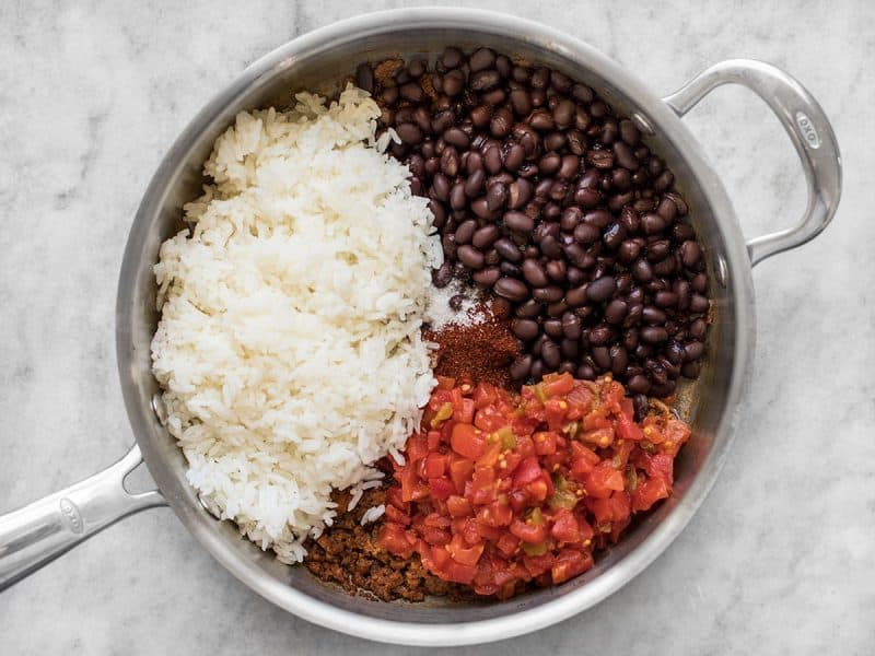 Add Cooked Rice Beans Tomatoes
