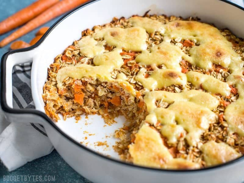 Carrot Cake Baked Oatmeal in casserole dish with some missing