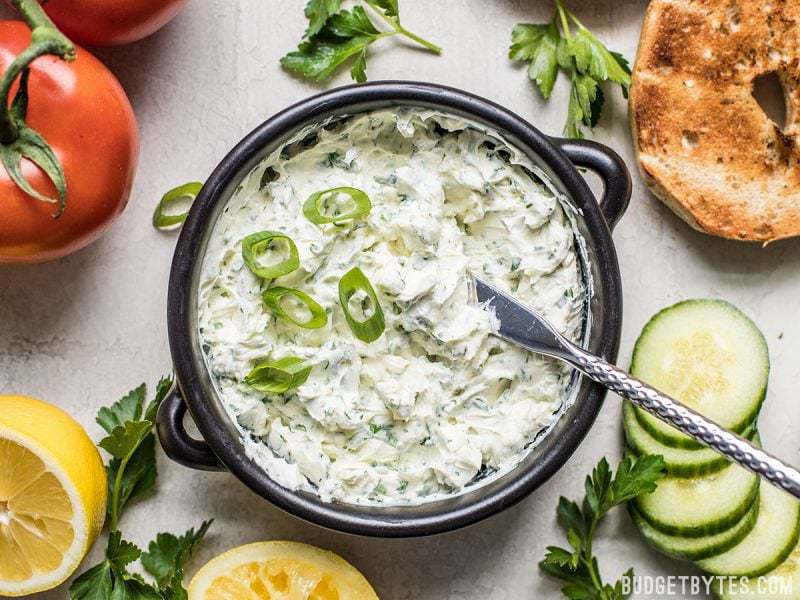 A bowl of finished Scallion Herb Cream Cheese Spread with green onion sprinkled on top