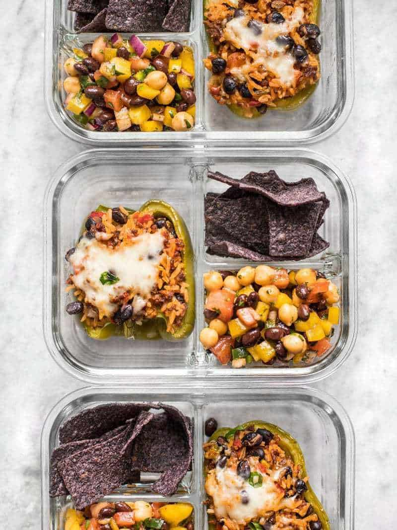 Stuffed bell peppers make the perfect meal prep item and are paired with Cowboy Caviar and chips for dipping in this Stuffed Bell Pepper Meal Prep. BudgetBytes.com