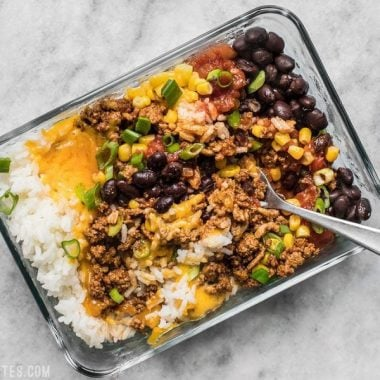 The Easiest Burrito Bowl Meal Prep that you can put together in about 30 minutes with minimal cooking, chopping, and nothing to pack on the side. Lunch can be easy and tasty! BudgetBytes.com