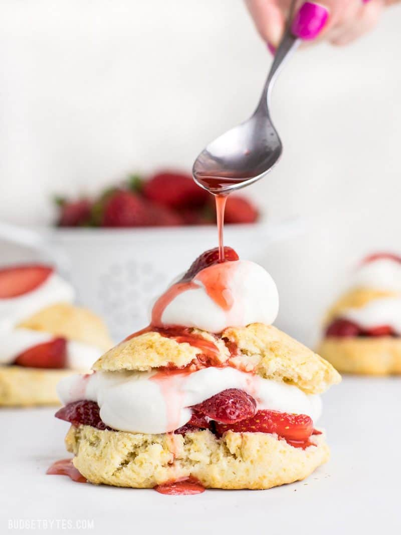 Strawberry Shortcake with Juice being drizzled over top