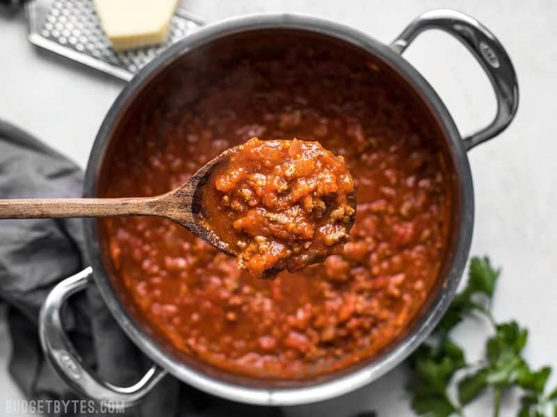 A ladle full of The Best Weeknight Pasta Sauce over the pot