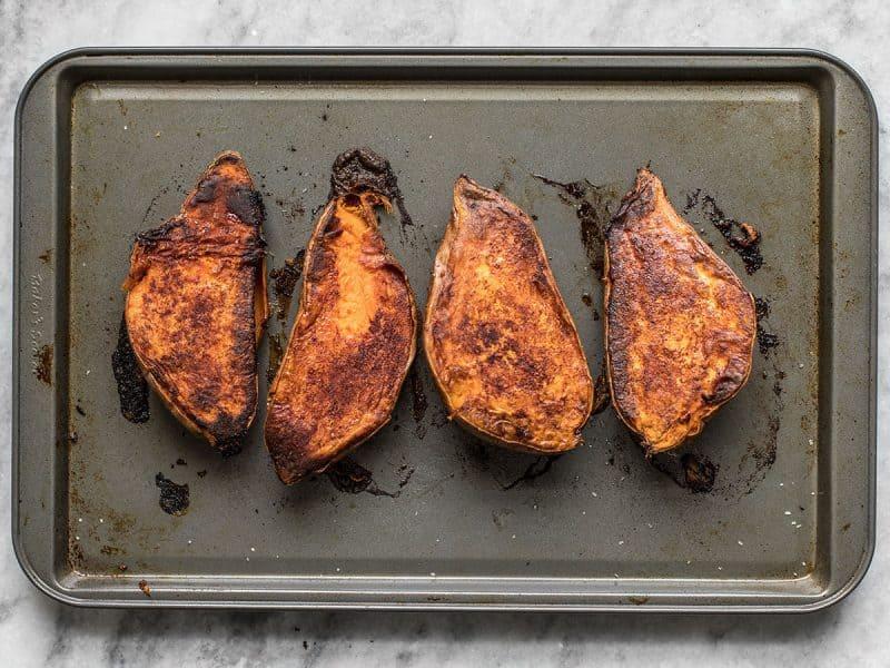Cinnamon Roasted Sweet Potatoes turned over on baking sheet