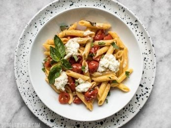 It only takes a few fresh ingredients make this Fresh Tomato Basil Pasta with Ricotta, the perfect light lunch or dinner for summer! BudgetBytes.com