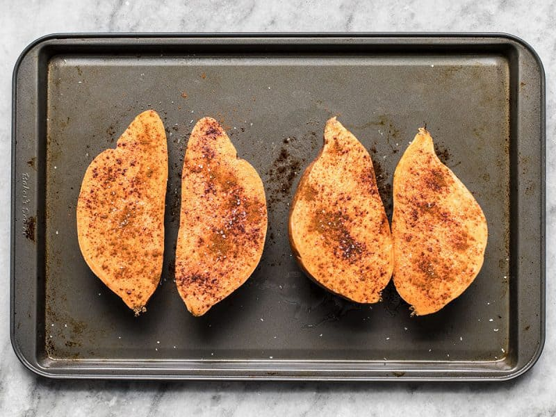 Season Sweet Potatoes on baking sheet