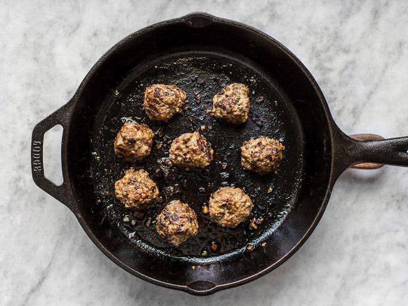 Cooked Beef Kofta Meatballs in cast iron skillet