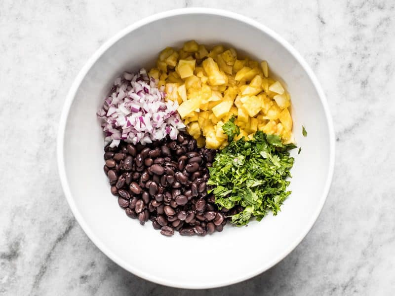 Pineapple Black Bean Salsa ingredients in a bowl