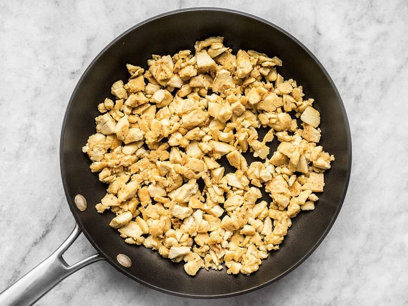 Fried tofu pieces in the skillet