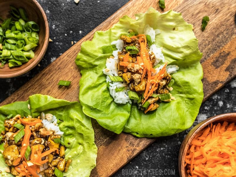 Close up of Hoisin Tofu Lettuce Cups arranged on a wooden cutting board