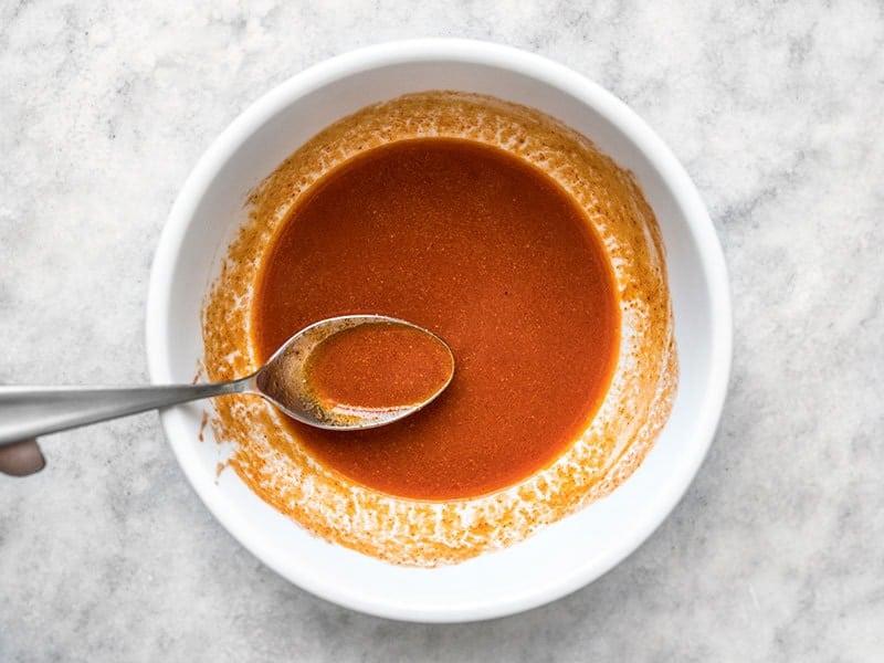 Buffalo Sauce in a small bowl