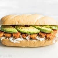 Buffalo Tempeh Sandwich on a Cutting Board