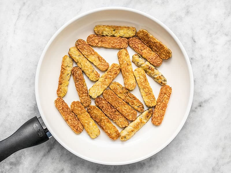 Fried Tempeh in a white ceramic skillet