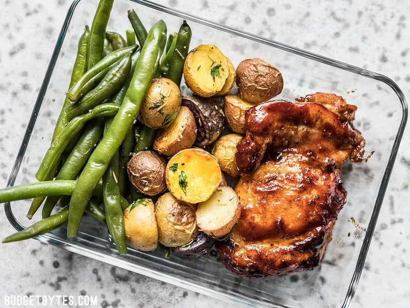 One glass Glazed Chicken Meal Prep container