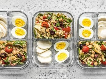 Line up of Orzo Salad Meal Prep Lunch Boxes