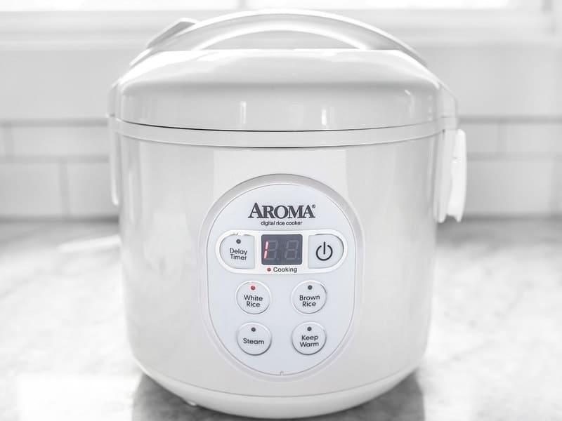 Rice cooker cooking, with one minute left on timer