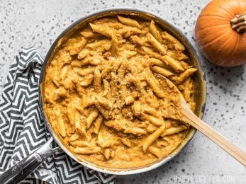 Skillet full of smoky, spicy, and creamy Chipotle Pumpkin Pasta.