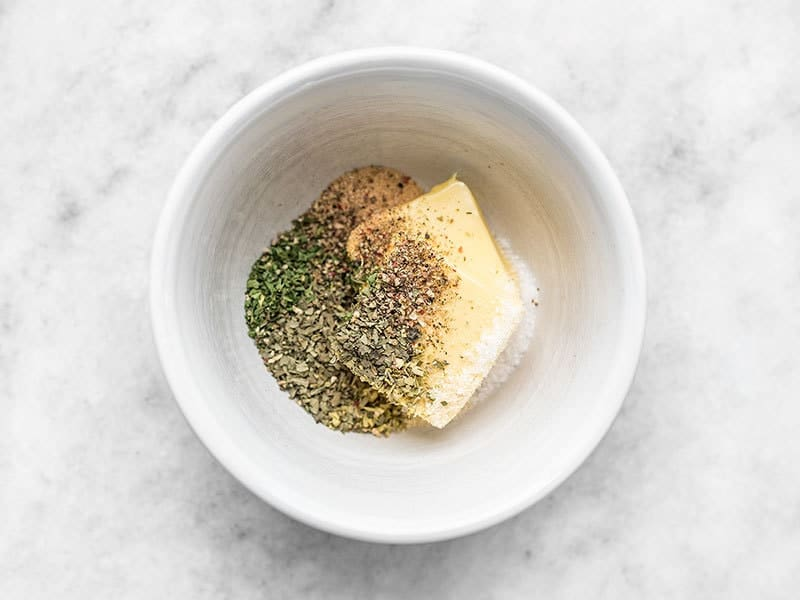 Garlic Herb Butter ingredients in a small white bowl