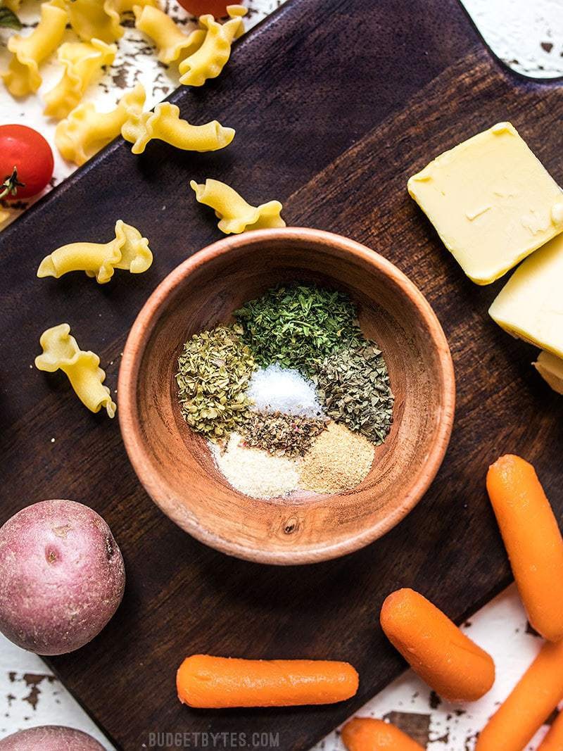 All-Purpose Garlic Herb Seasoning ingredients with vegetables, pasta, and butter