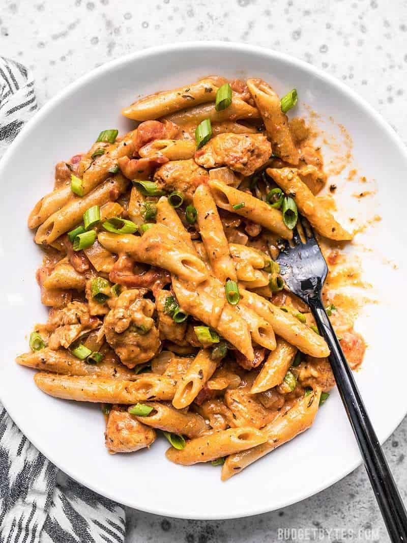A bowl full of One Pot Creamy Cajun Chicken Pasta being eaten.