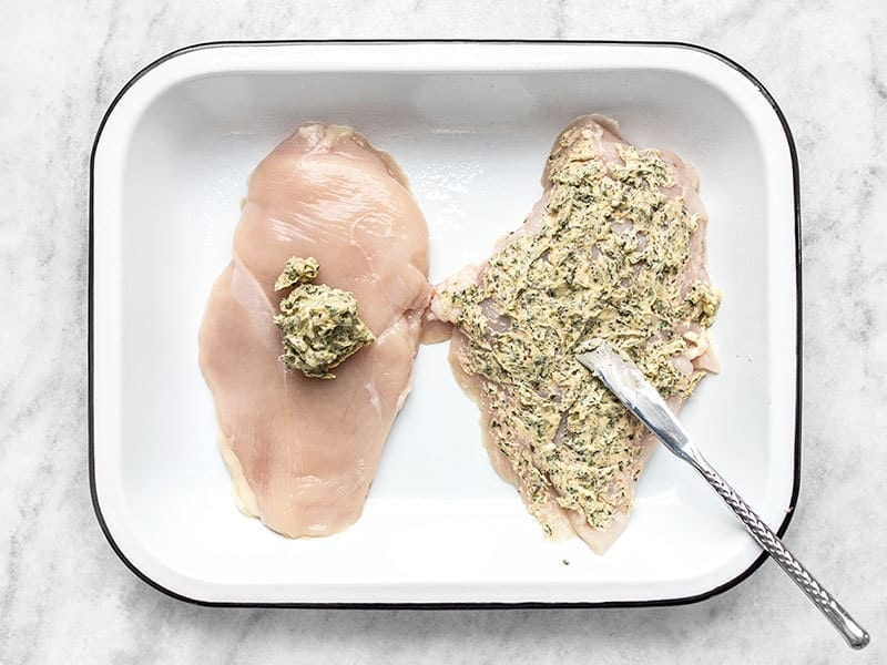 Spread Garlic Herb Butter Over Chicken