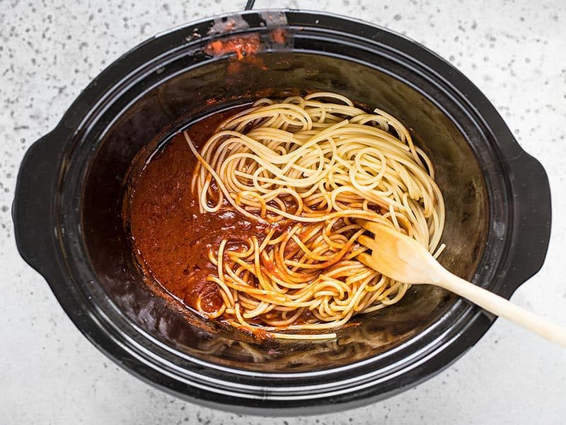 Add Cooked Spaghetti to the Slow Cooker