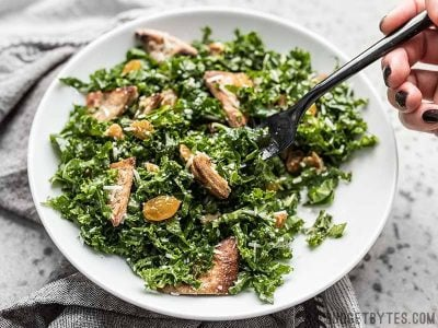 Kale and Toasted Pita Salad with Parmesan in the process of being eaten.