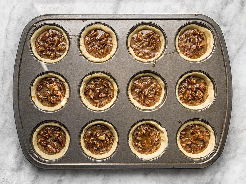 Mini Dark Chocolate Pecan Pies ready to bake