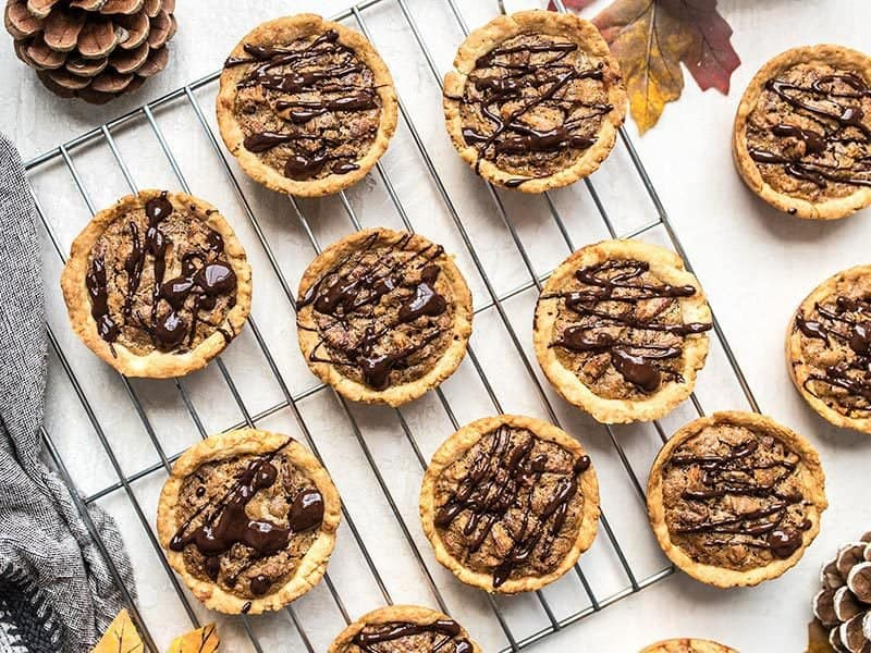 These easy Mini Pecan Pies studded with dark chocolate make the perfectly balanced and pre-portioned dessert for all of your holiday gatherings. Budgetbytes.com