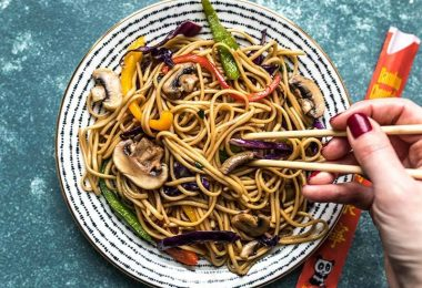 Eating a large plate of Salad Bar Vegetable Lo Mein